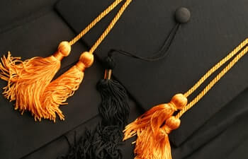 Honors Cords with a black cap background