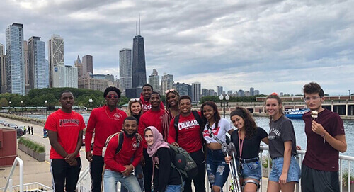 Students posing in front of Chicago skyline