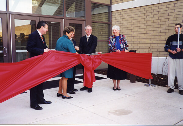Shannon center ribbon cutting ceremony in front of the Shannon Center with a big bow
