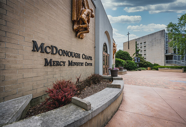 Picture of the side of the Mercy Ministry Center with a blue sky