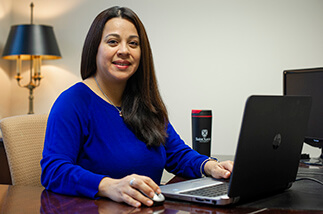 adult student in front of computer