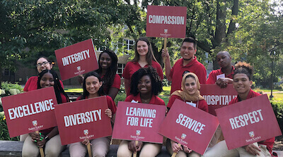Via leaders with the core value signs in the SXU quad near the arch