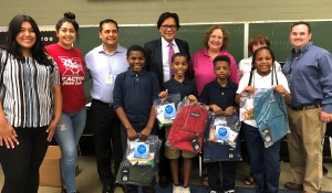 GSM donates backpacks to an elementary school